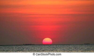 sunset on red clear sky on light orange cloud on the sea
