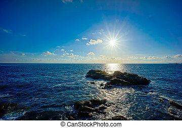 Sunset on rocky shore