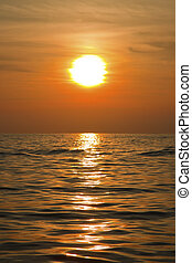Sunset on sea in portrait format