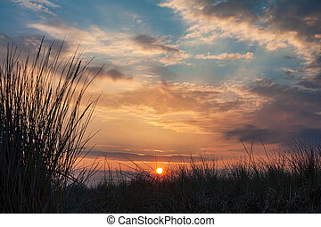 Sunset on shore of the Baltic Sea in Warnemuende, Germany.