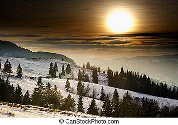 Sunset on snowy mountains