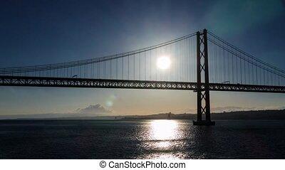 Sunset on the 25 de Abril Bridge in Lisbon