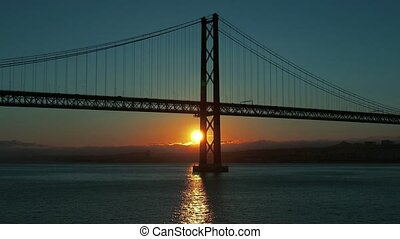 Sunset on the 25 de Abril Bridge in Lisbon, Portugal