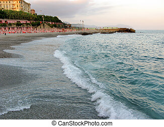 Sunset on the beach in Genoa Italy