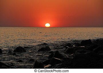 Sunset on the beach in summer