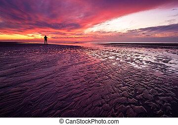 wild sunset at the dutch coast in callantsoog the Netherlands