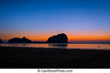 sunset on the beach of andaman sea