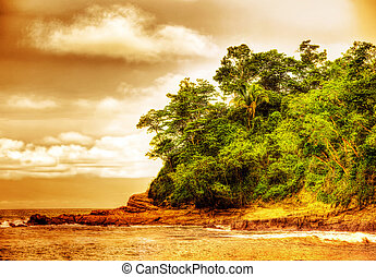 Picture of sunset on the beach of Costa Rica, beautiful island nature, jungle landscape, sunrise on the ocean coastline, romantic paradise beach, summer vacation, tropical resort