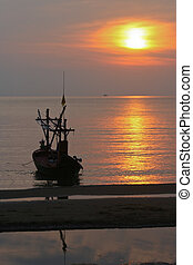 Sunset on the beach with boat
