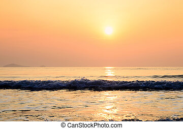 Sunset on the beach with wave