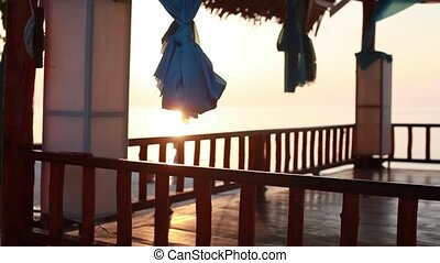 Sunset on the beach.wooden gazebo on the beach, Thailand....