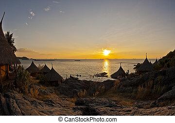 Sunset on the cliff of hut village