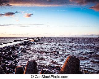 Sunset on the coast of Riga Gulf