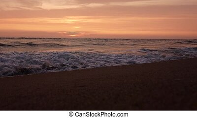 Sunset on the coast of the stormy sea - Sunset purple color...