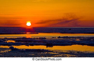 a view of Lake Manitoba at sunset
