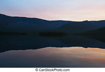 sunset on the lake in the mountains
