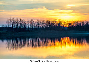 Sunset on the lake. Reflections in water.
