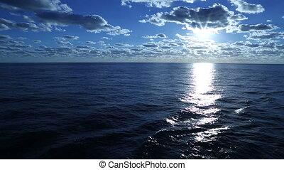 Sunset on the ocean, slow motion