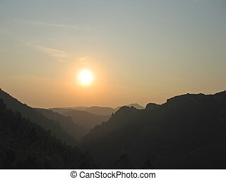 Sunset on the provencal mountains with the sun - Esterel cap - Azur coast - South of France.