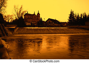 Sunset on the river and church in Czech Republic. Autumn...