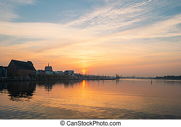 Sunset on the river Warnow in the city Rostock, Germany