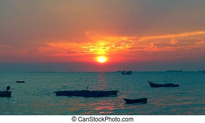 sunset on the sea and fishing boat parking