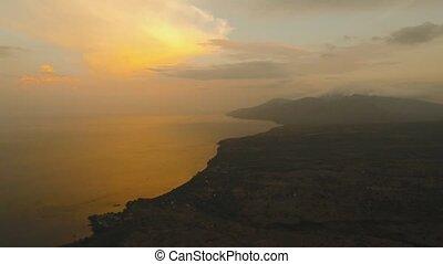 Sunset on the sea coast. Bali, Indonesia. - Sea coast at...