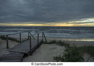 Sunset on the sea from sand beach on the Curonian spit