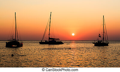 Sunset on the sea with boat