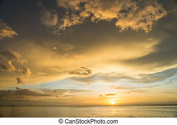 sunset on the sea with cloudy sky background