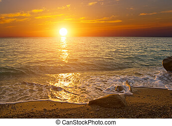 Sunset on the shore of sea