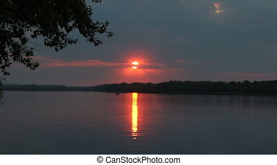 Sunset on the shore of the lake