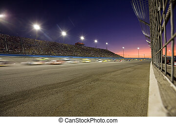 Sunset on the Speedway - Sunset on a racetrack during an...
