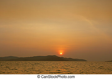 Sunset on the view of the island in the sea.