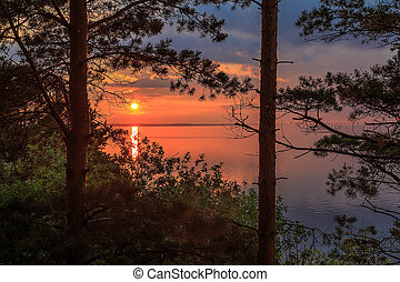 Sunset on the Volga River, the sun sets over the horizon