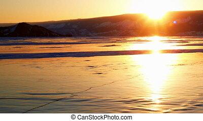 Sunset on the winter lake