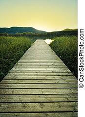 Sunset on the wooden pier of Lake Banyoles