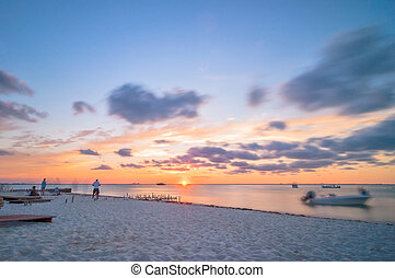 sunset on tropical beach in Isla Mujeres, Mexico - Isla...