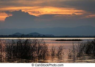 Sunset on tropical lake