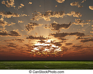 Sunset or sunrise over grass landscape