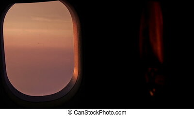 Sunset Orange Clouds Sky out of Airliner Window