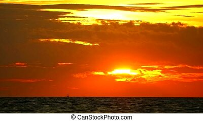 sunset orange red sky and red cloud moving on sea