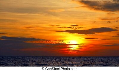 sunset orange sky and red cloud moving and wave on sea