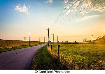 Sunset over a country road and farm fields near Hanover, Pennsylvania.