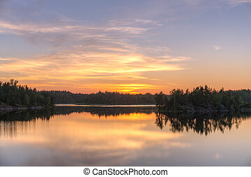 sunset over a forest lake