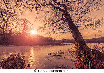 Sunset over a frozen lake in the winter