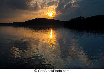 Sunset over a lake in summer