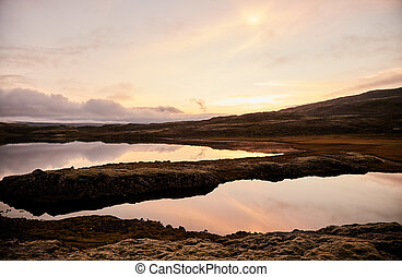 Sunset over a mountain lake in Iceland