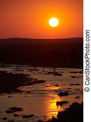 Sunset over a river landscape