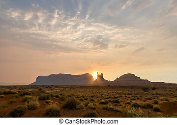 sunset over a rock butte in Monument Valley